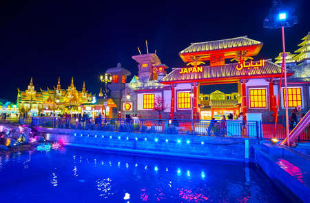 DUBAI, UAE - MARCH 5, 2020: The Japan Pavilion of Global Village Dubai behind the canal, illuminated with bright blue lights, on March 5 in Dubai Redakční