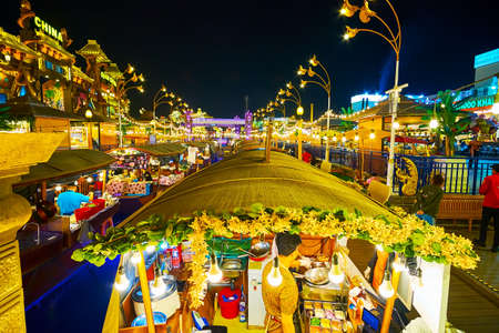 DUBAI, UAE - MARCH 5, 2020: The canal with food boats of Thai Floating Market, located in Global Village Dubai, on March 5 in Dubai