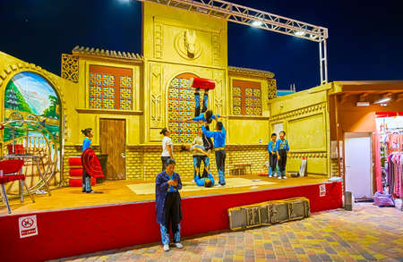 DUBAI, UAE - MARCH 5, 2020: The repetition of acrobatic circus on stage of China Pavilion of Global Village Dubai, on March 5 in Dubai