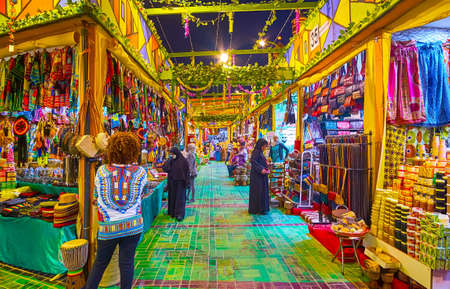 DUBAI, UAE - MARCH 5, 2020: Explore Africa pavilion of Global Village Dubai, offering large amount of authentic items - garment, accessories, toys, souvenirs, handicrafts, on March 5 in Dubai Imagens - 151082110