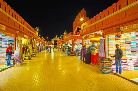 DUBAI, UAE - MARCH 5, 2020:  Walk textile alley of India Pavilion of Global Village Dubai with stalls, offering colored fabrics, decorated with prints, embroidery and lurex, on March 5 in Dubai