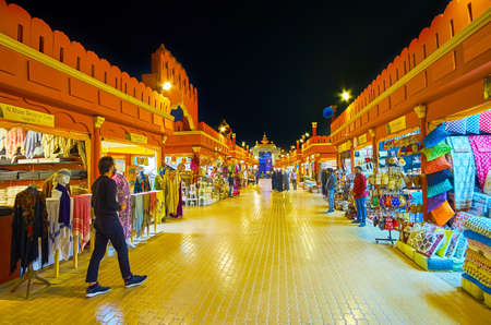 DUBAI, UAE - MARCH 5, 2020: The alleyway of India Pavilion of Global Village Dubai with stalls, offering textiles, scarves, garment, accessories, handmade wooden furniture, on March 5 in Dubai