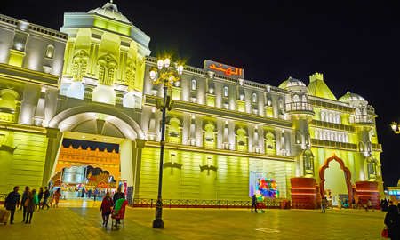 DUBAI, UAE - MARCH 5, 2020: The facade of India Pavilion of Global Village Dubai, decorated with modest molding and dimmed illumination, on March 5 in Dubai
