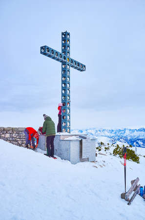 EBENSEE, AUSTRIA - FEBRUARY 24, 2019: The mdern metal construction of Europakreuz (Europe Cross) with stones from all EU countries stands on peak of Alberfeldkogel Mount, on february 24 in Ebensee