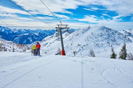 The sportsmen use button ski lift to reach the mountain top of Feuerkogel, Ebensee, Salzkammergut, Austria