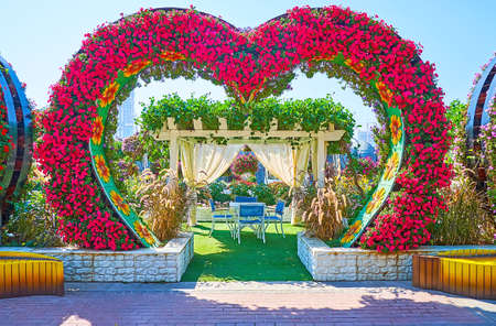 DUBAI, UAE - MARCH 5, 2020: Enjoy the open air terrace of the restaurant in Miracle Garden, decorated with heart arch, on March 5 in Dubai Publikacyjne