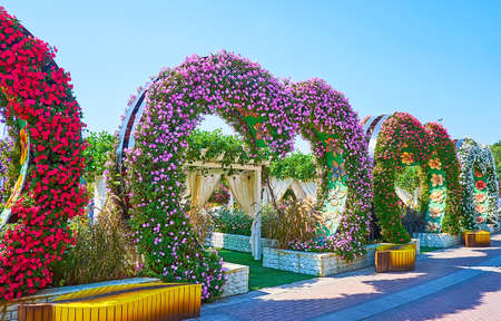 DUBAI, UAE - MARCH 5, 2020: The heart-shaped  arches, leading to the open air terrace of the restaurant in Miracle Garden, on March 5 in Dubai Publikacyjne