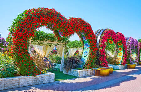 DUBAI, UAE - MARCH 5, 2020: The colored heart arches, decorated with bright petunias in Miracle Garden, on March 5 in Dubai