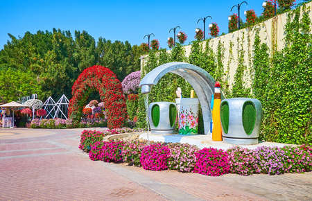 DUBAI, UAE - MARCH 5, 2020: The funy faucet fountain in Miracle Garden, lined with petunias, on March 5 in Dubai