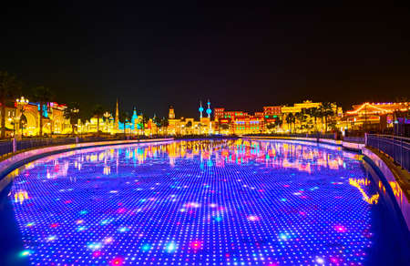 DUBAI, UAE - MARCH 5, 2020: Watch the light show on underwater LED screen in pond of Global Village Dubai, lined with pavilions of different countries, on March 5 in Dubai