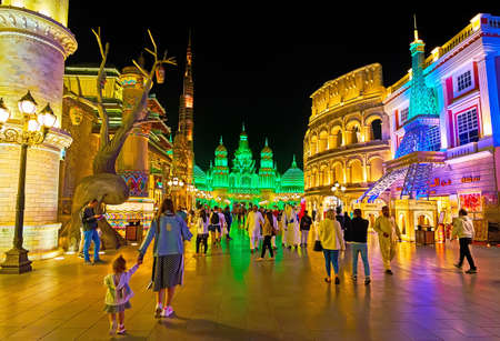 DUBAI, UAE - MARCH 5, 2020: The alley, leading to the Gate of the Worls, decorated with replicas of world's known buldings - Paris Eiffel Tower, Rome Colosseum, Dubai Burj Khalifa, Global Village, on March 5 in Dubai