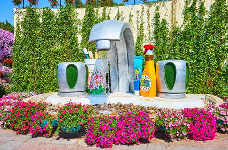 DUBAI, UAE - MARCH 5, 2020: The interesting faucet fountain, pouring water to the sink, Miracle Garden, on March 5 in Dubai
