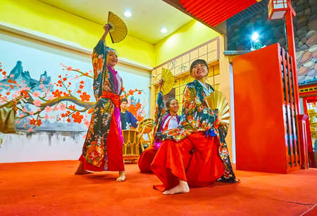 DUBAI, UAE - MARCH 5, 2020: Enjoy performance of traditional Japanese dance with fans in Japan Pavilion in Global Village Dubai, on March 5 in Dubai