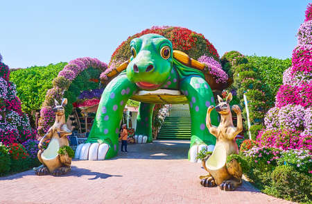 DUBAI, UAE - MARCH 5, 2020: The beautiful turtle pavilion and sculptures of kangaroos in Miracle Garden, on March 5 in Dubai Publikacyjne
