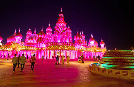DUBAI, UAE - MARCH 5, 2020: The bright illumination of fairytale Gate of the World of Global Village Dubai, decorated with carved onion-domes and gilt patterns, on March 5 in Dubai Editorial
