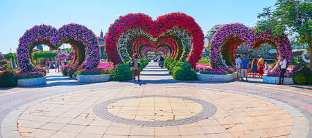 DUBAI, UAE - MARCH 5, 2020: Panorama of the Miracle Garden square with three alleyways, decorated with colorful heart-shaped arches, on March 5 in Dubai