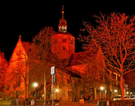 The bright red illumination of Evangelical Lutheran Cathedral of St Boniface (Munster St Bonifatius) in red lights, Munsterkirchhof, Hamelin, Germany