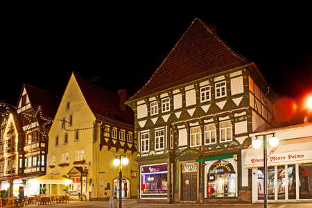 HAMELIN, GERMANY - NOVEMBER 22, 2012: The Backerstrasse street boasts lots of preserved half-timbered houses with colorful painted decors and carvings, on November 22 in Hamelin Editorial
