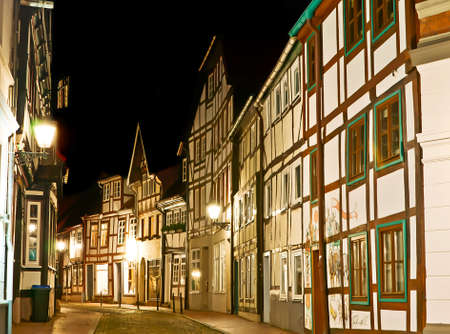 The Grossehofstrasse is a narrow winding street of old town, lined with historic half-timbered houses, Hamelin, Lower Saxony, Germany