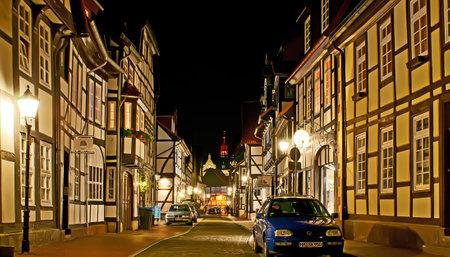 HAMELIN, GERMANY - NOVEMBER 22, 2012: Enjoy the evening walk through the Alte Marktstrasse with  historic living half-timbered houses, on November 22 in Hamelin