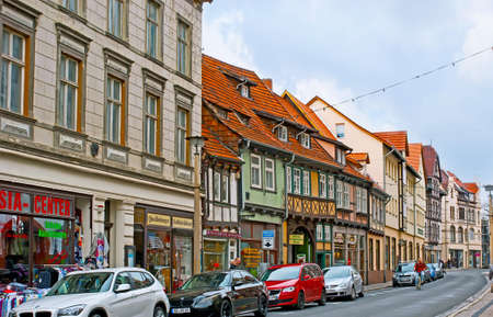 QUEDLINBURG, GERMANY - NOVEMBER 22, 2012: The Heilige-Geist-Strasse street boasts many stores, located in historic buildings, on November 22 in Quedlinburg