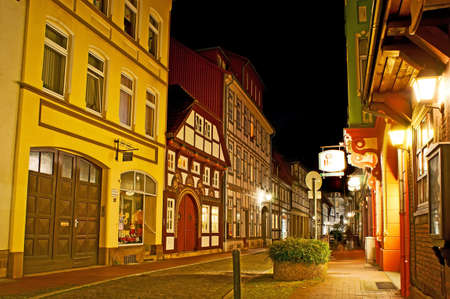 HAMELIN, GERMANY - NOVEMBER 22, 2012: The scenic buildings of Neue Marktstrasse with stores, restaurants, hotels and historic living half-timbered houses, on November 22 in Hamelin