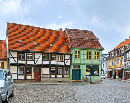 The Altstadt of Quedlinburg boasts scenic living half-timbered houses with old red tile roofs, Harz, Germany