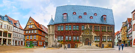 Panorama of the Markt - Market Square with historical building of the City Hall (Rathaus) and medieval half-timbered houses around it, Quedlinburg, Harz,  Germany