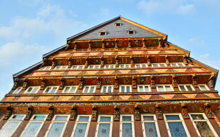 HILDESHEIM, GERMANY - NOVEMBER 22, 2012: The half-timber building of Butchers' Guild Hall, located in Marktplatz, boasts impressive facade with colorful paintings and fine carvings, on Nov 22 in Hildesheim