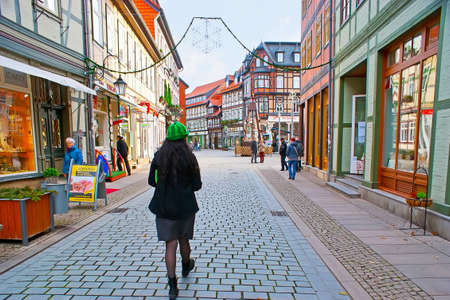 WERNIGERODE, GERMANY - NOVEMBER 23, 2012: The Breite Strasse (street) is the central pedestrian walkway of the town with many stores and cafes, on November 23 in Wernigerode