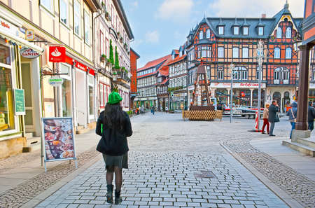 WERNIGERODE, GERMANY - NOVEMBER 23, 2012: The Breite Strasse (street) boasts lots of colorful half-timbered houses with restaurants and souvenir stores, on November 23 in Wernigerode Editorial