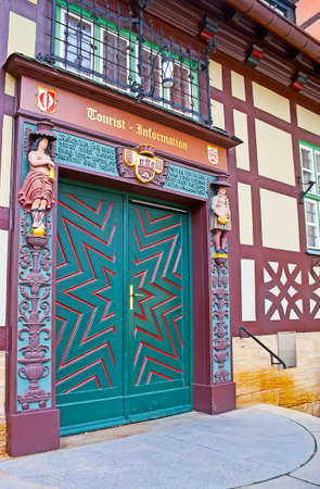 WERNIGERODE, GERMANY - NOVEMBER 23, 2012: The ornate wooden door with carved frame in building of Tourist Info Center, located adjacent to Rathaus (Town Hall), on November 23 in Wernigerode