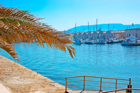 Walk the old pier and watch historic Venetian port with extant shipyards and moored yachts, Chania, Crete, Greece Banco de Imagens