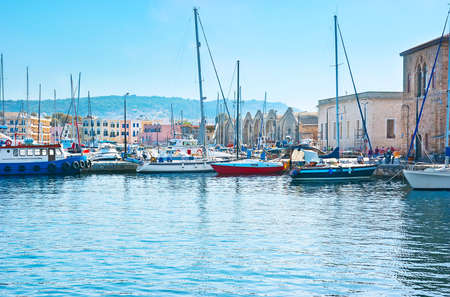 The medieval Venetian port with sailing yachts and motor boats, Chania, Crete, Greece