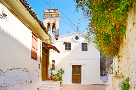 The small Agia Sofia church is hidden among the narrow hilly streets of Psaromachala district, Acronauplia castle hill, Nafplio, Greece