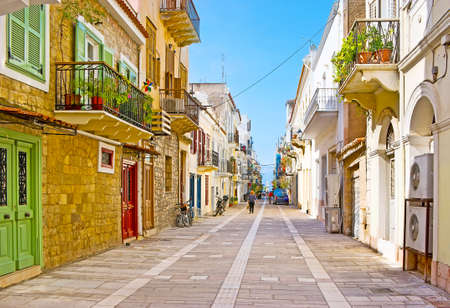 Walk along the old houses of Othonos street, watch the plants in pots, colorful doors and shutters, Nafplio, Greece Banco de Imagens
