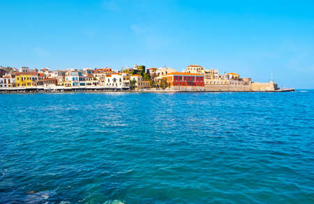 port of Chania overlooks  medieval housing of Akti Kountourioti  and stone rampart of Firkass Fortress