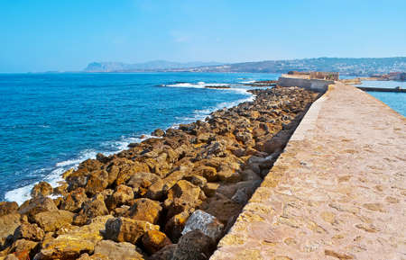 The old breakwater on the coast of Chania Bay, Crete, Greece