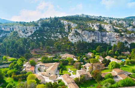The narrow valley in Alpilles mountains is occupied with gardens and old mansions of Les Baux-de-Provence, France