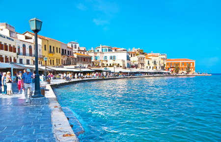 CHANIA, GREECE - OCTOBER 14, 2013: Walk  Akti Kountourioti , stretching along  harbor and boasting medieval houses and lots of tourist restaurants,  Oct 14 in Chania