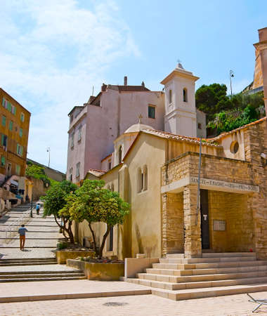 The old St Erasme church, located in lower town, next to the harbor of Bonifacio, the narrow hilly ascent leads to the upper town - Ville Haute, located in Citadel atop the hill, Corsica, France