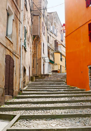 Explore old town with its hilly naroow streets, shabby houses, stone staircases and tiny yards, Corte, Corsica, France