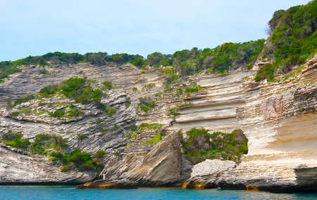 Bonifacio is famous for its unique landscape, containing tall white limestone cliffs, covered with maquis shrublands, Corsica, France Banco de Imagens