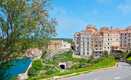 The dense old living houses of Bonifacio upper town, located atop the cliff, Corsica, France Banco de Imagens