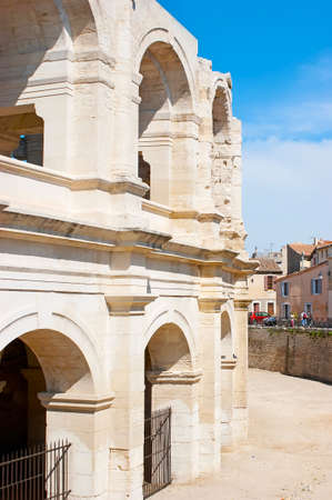 Walk along the old stone wall of the Amphitheatre of Arles, one of the city symbols, France