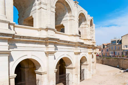 The white stone wall with arched windows of the Amphitheatre of Arles, France 写真素材