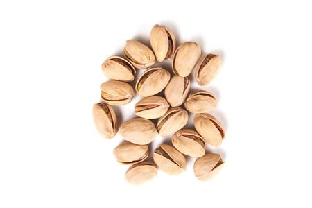 pistachios: some pistachios isolated on white