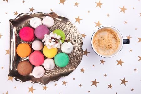 macaroon, marshmallow and flower on a vintage silver tray photo