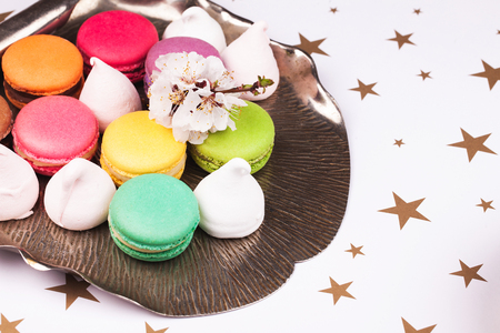 silver tray: macaroon, marshmallow and flower on a vintage silver tray Stock Photo