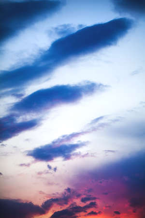 Sunset blue, orange, red sky and clouds background Stock Photo